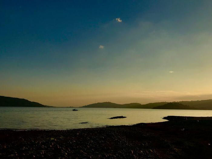 a peacefull place Sunset Bluesky Simple Wonderful Indonesia darkness and light Wonderful Wonderful Day Peaceful View Water Sky Sea Scenics - Nature Tranquility Beauty In Nature Tranquil Scene Nature No People Beach Outdoors Horizon Idyllic Silhouette Land