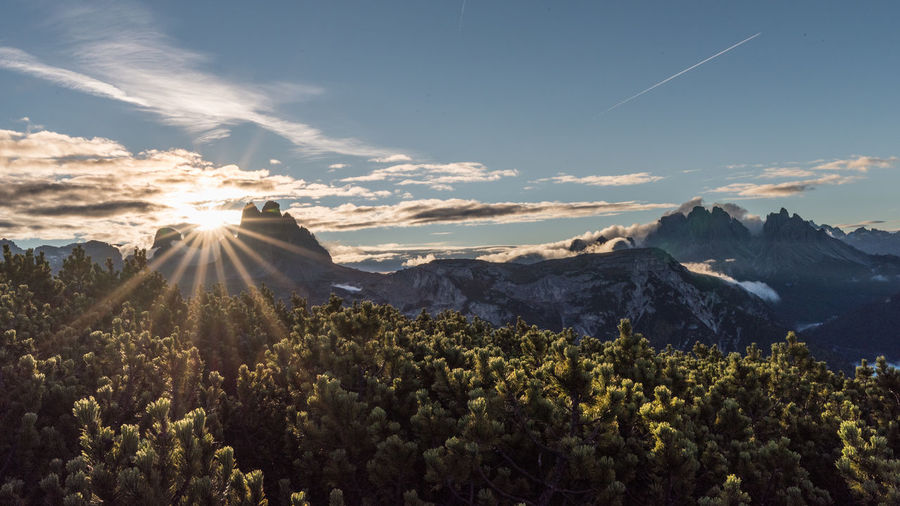 Sunrise over Tre Cime Sunrise Sky Clouds Early Morning Mountains Nature Outdoors Landscape Beauty In Nature Scenics - Nature Mountain Range Sun Mountain Peak Sunbeam Plant Mountain Tranquility Sunlight Day