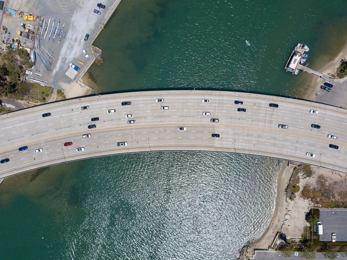 Aerial view of Pacific Coast Highway over water Water High Angle View Architecture Built Structure Building Exterior Day Sea Nature Nautical Vessel City Transportation Aerial View Outdoors Mode Of Transportation No People Waterfront Connection Newport Beach Orange County Southern California Pacific Coast Highway PCH Drone View
