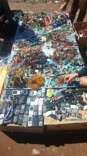Camera - Photographic Equipment Human Body Part Human Hand Glasses Used Things Used Stafs Second Hand Marcet Cellphone Photography Cellphone Old Cellphones Multi Colored High Angle View Sunlight Close-up Display For Sale Collection Market Stall Market