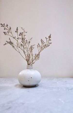 Bunch of dry bouquet in a white vase decorated on the white marble table in the white room, minimal style Clean Background Copy Space Bunch Of Flowers Branches Ceramic Pottery White Wall Minimal Marble Table Dry Flower  Bouquet Vase Of Flowers No People Table Indoors  Nature Winter Plant Cold Temperature Decoration Close-up Creativity