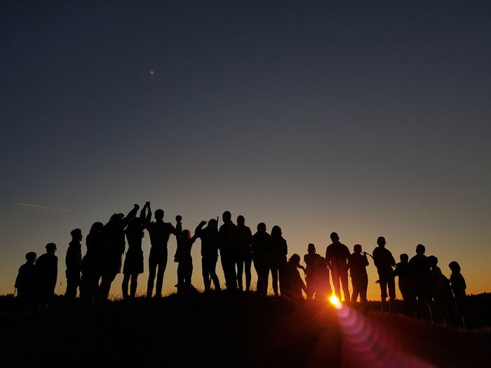 Sunrise_sunsets_aroundworld Team Teamwork Holding Hands Spirituality Spirit Shadows & Lights Silhouette Sunset People Large Group Of People Adult Togetherness Arrival Outdoors Following Men Adults Only Only Men Mammal Domestic Animals Day King - Royal Person Sky Politics And Government