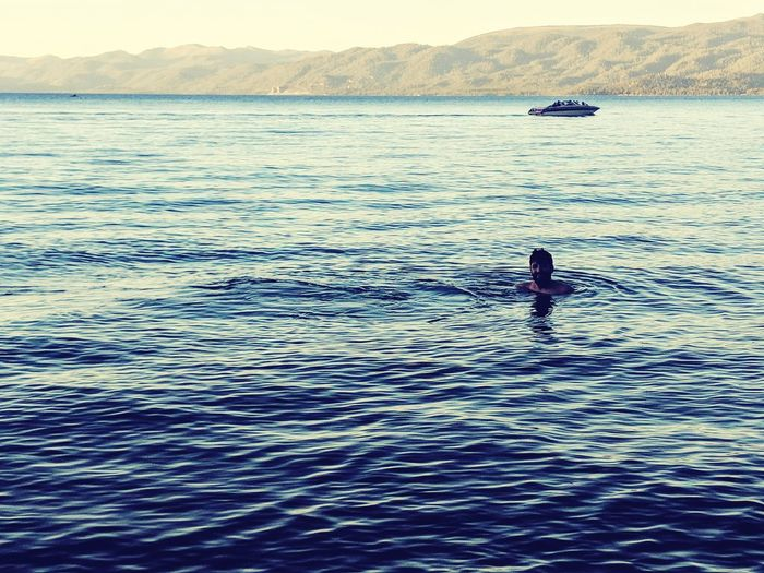 time for a dip Swimmer Treading Water Boat Swimming Silhouette Lake Lake View Lake Tahoe California USA California Millenials Water Water Reflections Water Paddleboarding Oar Sea Full Length Summer Adventure Nautical Vessel Rippled Sky Outline Floating In Water Water Vehicle Sailing Boat