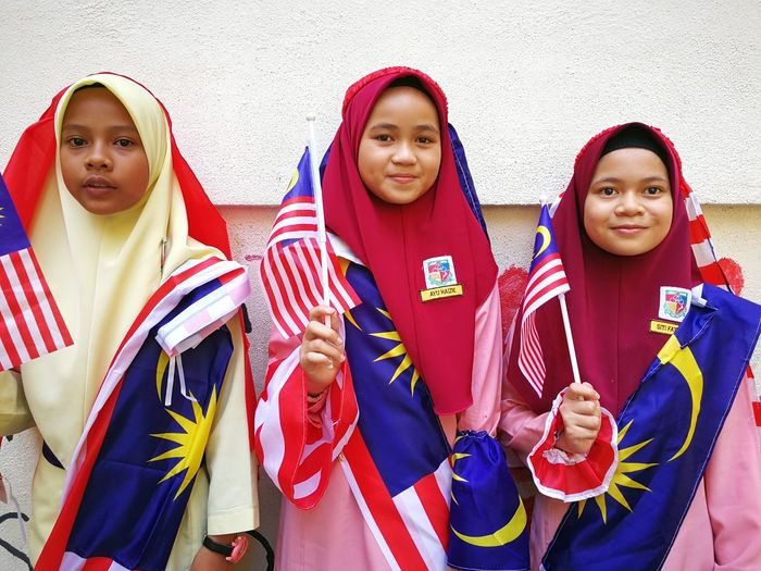 merdeka day Portrait Looking At Camera Togetherness Young Women Patriotism Traditional Clothing Hijab Religious Dress Islam Headscarf Wearing Festival