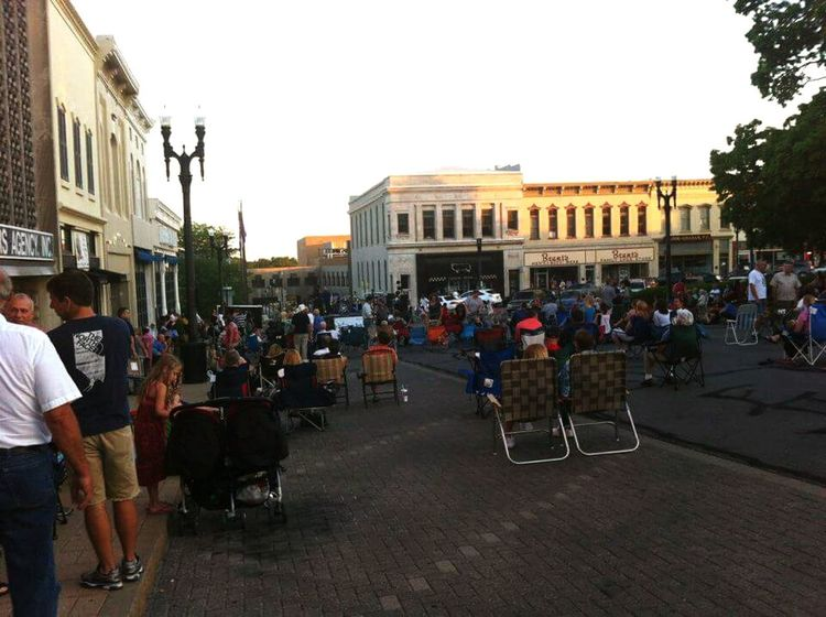 Town Square Small Town USA People Men Women Dusk Familys Small Shops Outdoor Concert Historic