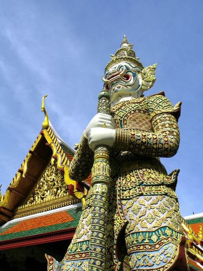 Low Angle View Of Demon At Wat Phra Kaew Against Sky