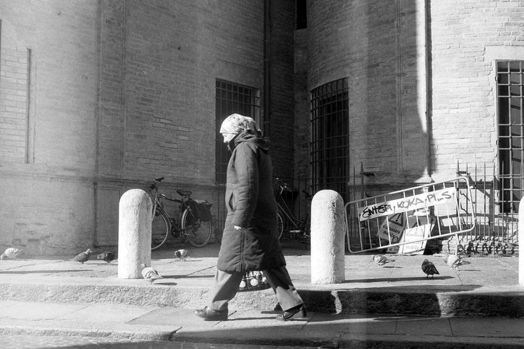 Stories From The City Check This Out EyeEm Best Shots Streetphotography Analogue Photography Italy Woman Bnw City Full Length Men Architecture Building Exterior Built Structure Sidewalk Street