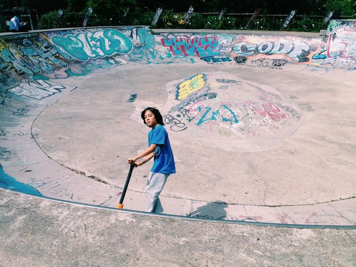 Skateboard Park Leisure Activity High Angle View Young Adult Looking At Camera Portrait Boy Kid Teenager Teen Skater Skater Boy Skateboarding Skateboard Active Graffiti Outdoors Sport Scooter Boys Active Lifestyle
