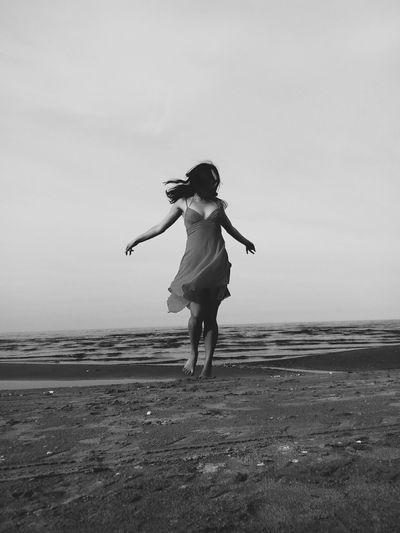 Full Length Of Woman At Beach Against Clear Sky