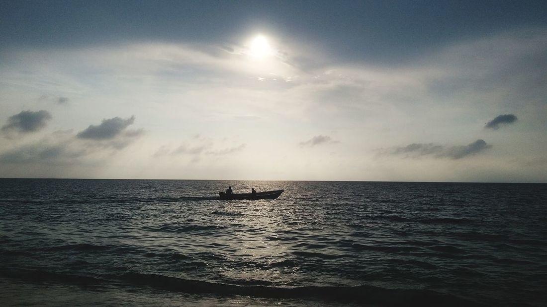 fisherman Water Sea UnderSea Sunset Beach Sun Reflection Sky Horizon Over Water Cloud - Sky Seascape Sunbeam Shining Sunrise