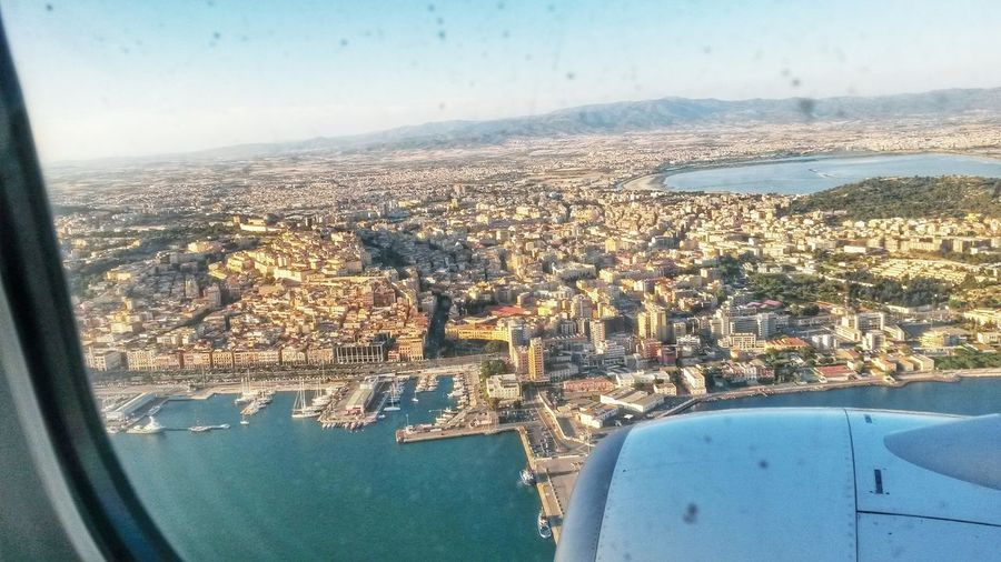Looking Through Window Window Land Vehicle Plane Transportation Travel Sky Panoramic View Panorama Looking Down Looking Out Of The Window Looking From A Plane Panorama Cagliari Island Coast Cagliari From The Plane Cityscape Sardinia Sardinia Sardegna Italy  Harbour Harbor EyeEmNewHere Flying High