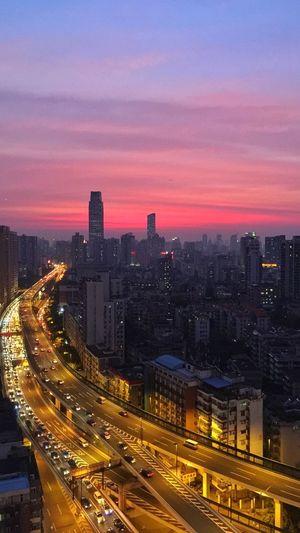 Illuminated cityscape at sunset