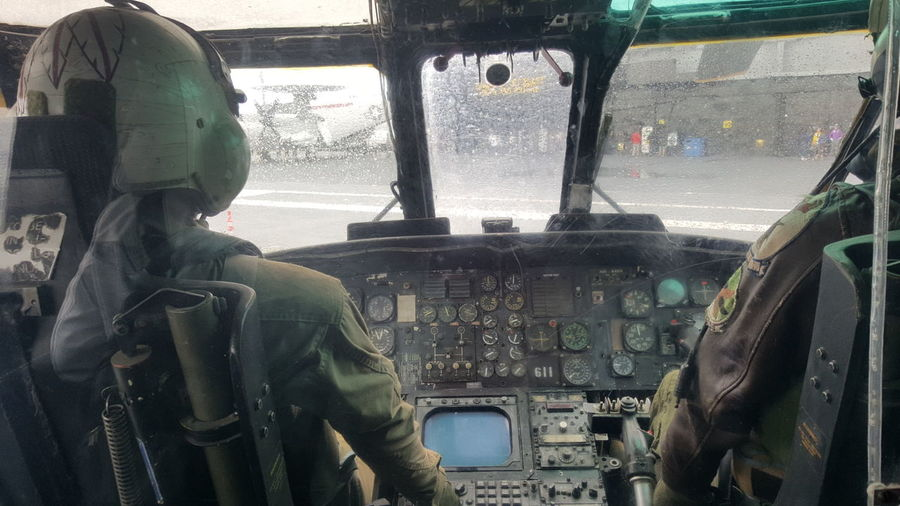 testing flight. Cockpit Pilot Transportation Window Military Vehicle Interior Military Uniform Adults Only Headwear Airplane Control Panel Helmet Day War Adult One Person Protective Mask - Workwear Men People Aerospace Industry