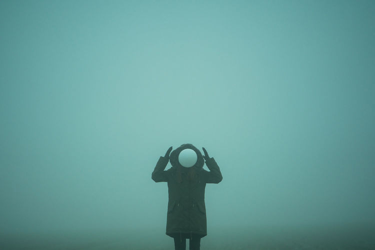 Person With Balloon Standing In Foggy Weather