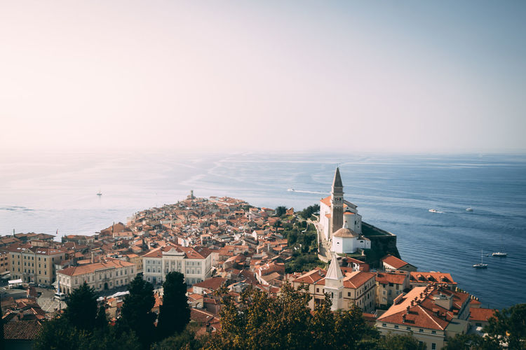 Building Exterior Architecture Built Structure Building City Cityscape Sky Nature Religion High Angle View Travel Destinations Belief No People Water Community Outdoors TOWNSCAPE Piran Slovenia Sea Sundown Birdseyeview Ships Boat