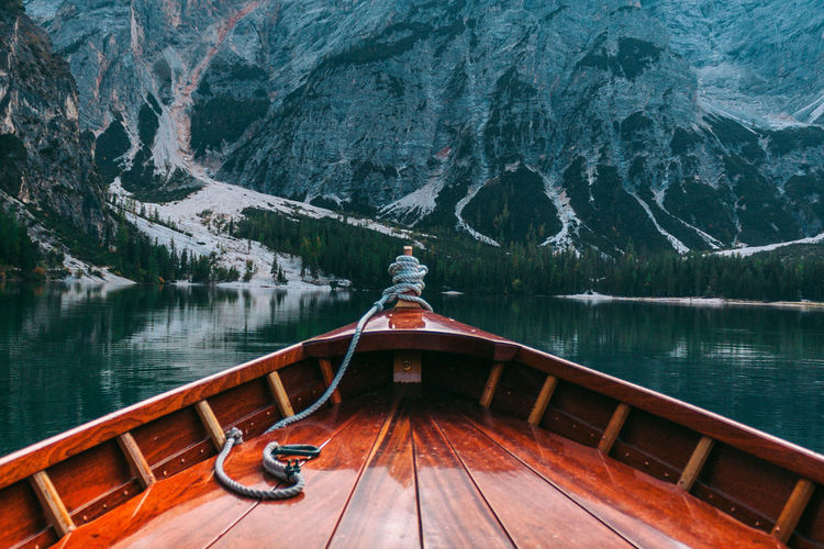 Braies Lake Dolomites Adventure Beauty In Nature Boat Deck Braies Lake Day Forest Kayak Lake Mountain Mountain Range Nature Nautical Vessel No People Outdoors Scenics Snow Tranquil Scene Tranquility Travel Destinations Water Wood - Material Fresh On Market 2018