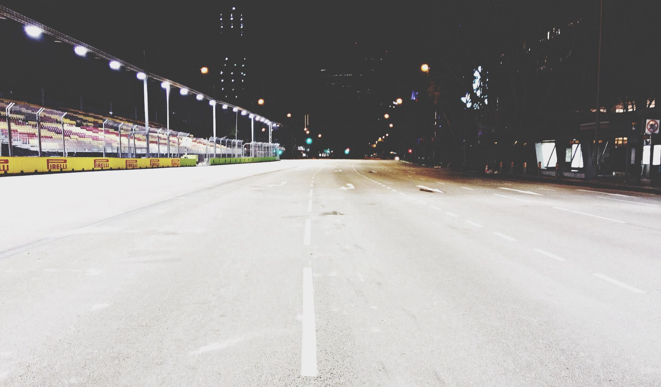 night, the way forward, illuminated, transportation, diminishing perspective, vanishing point, road, snow, street light, winter, empty, road marking, cold temperature, street, long, lighting equipment, empty road, outdoors, weather, built structure