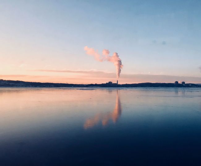 Views from the early morning train to the city 💯 Train Steam Sunrise Sunrise Smoke - Physical Structure Industry Emitting Factory Air Pollution Chimney Outdoors Environment Sky Water Reflection No People Day