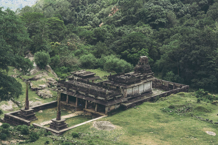 View of temple amidst trees and building in forest