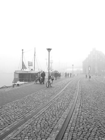 Dockland Docks Wismarhafen Urban Geometry Lines, Shapes And Curves Walking Around Street Photography Urbanphotography EyeEm Best Shots EyeEm Best Shots - Black + White Light And Shadow Foggy Morning Fog_collection Learn & Shoot: Leading Lines Black And White Photography Streetphoto_bw Contrast Bnwphotography EyeEm Masterclass Lines&curves Hafenfotografie People Photography