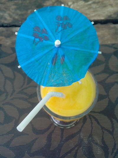Fresh mango shake for summer Beverage Drinks Foods & Beverages Fresh Juices Fresh Mango Leaves Fresh Mango Shake Mango Juice Mango Shake Umbrella