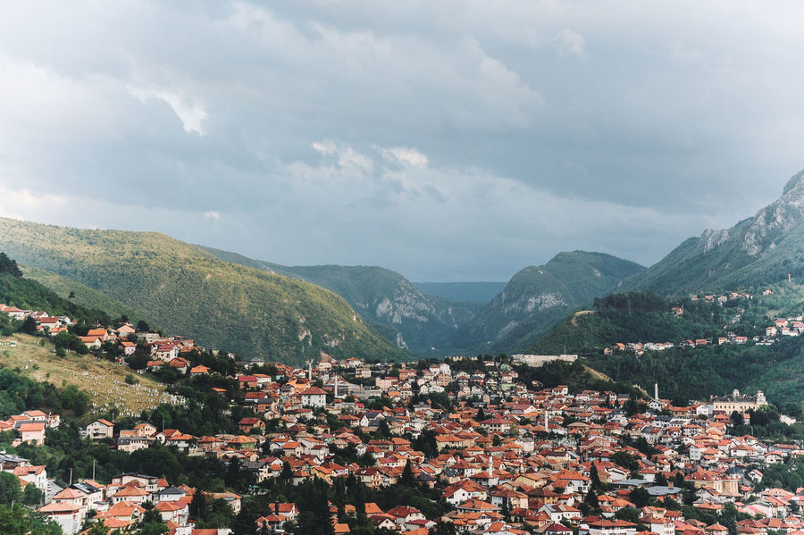 BIH Bosnia And Herzegovina Architecture Beauty In Nature Bosnia Building Exterior Built Structure Cityscape Cloud - Sky Community Day House Mountain Mountain Range Nature No People Outdoors Sarajevo Scenics Sky Town Tranquility Tree