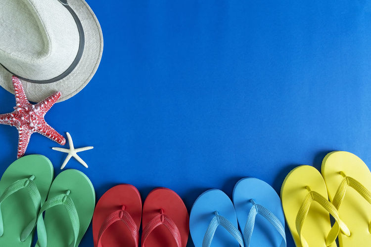 Directly above shot of multi colored shoes against blue background