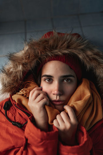 Portrait of woman with red eyes closed in winter