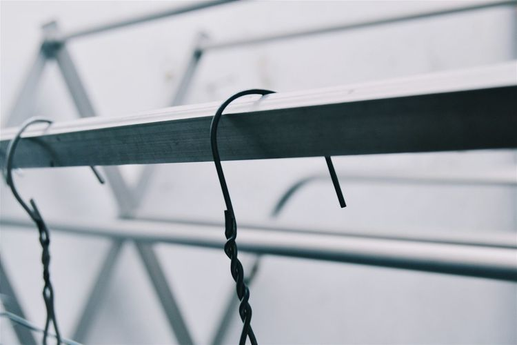 Close-Up Of Hooks On Metal Rod