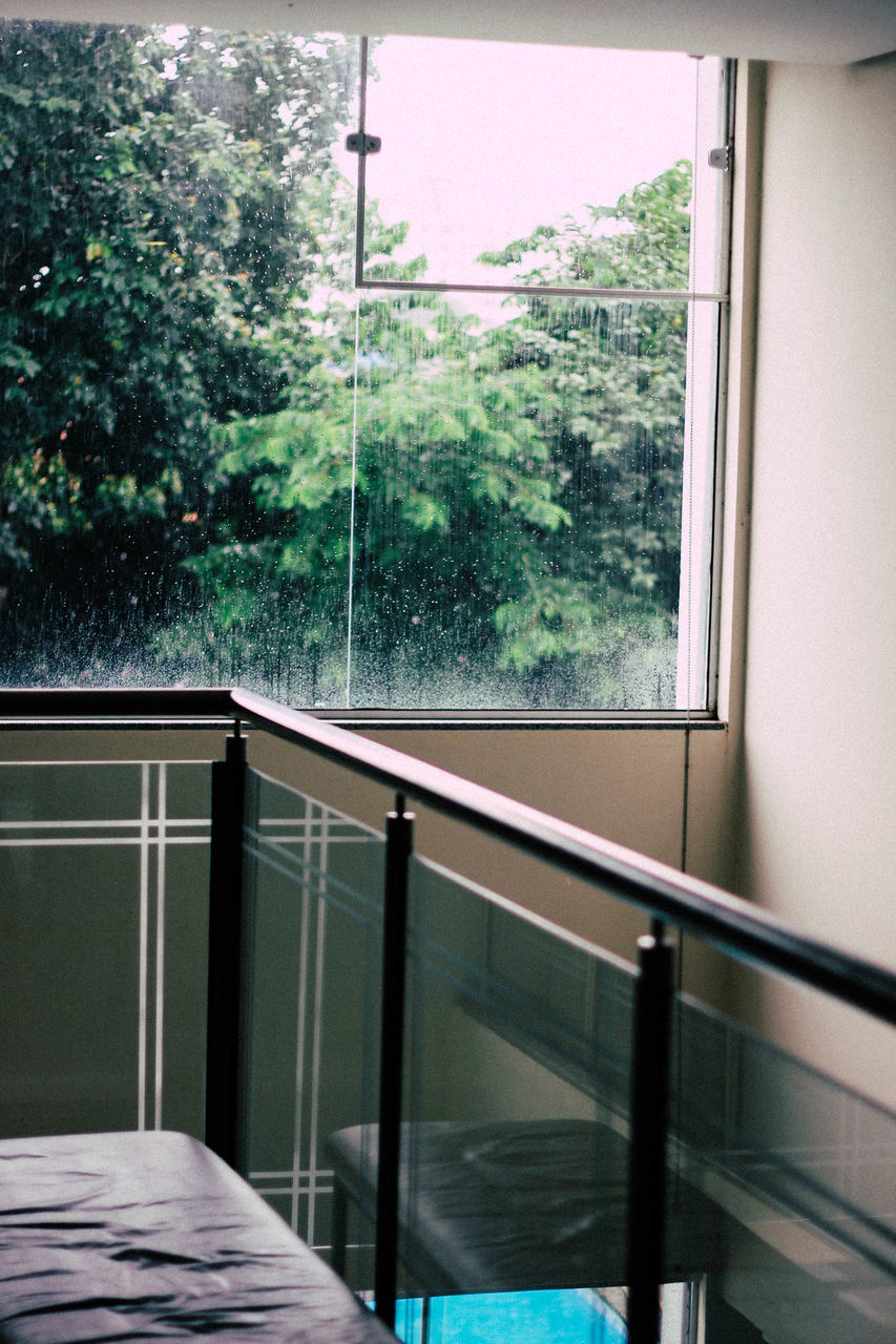 Glass Railing Against Window At Home