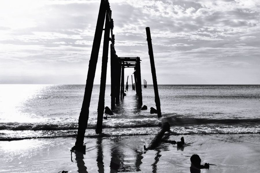 scrap of wood bridge at Khao Pilai Beach, Thailand Khao Pilai Beach Thailand Woodbridge Old Scrap Travel Holiday Sea Beach Cloud - Sky Water Horizon Over Water Reflection Sky Scenics Outdoors Silhouette No People Beauty In Nature Nature Day