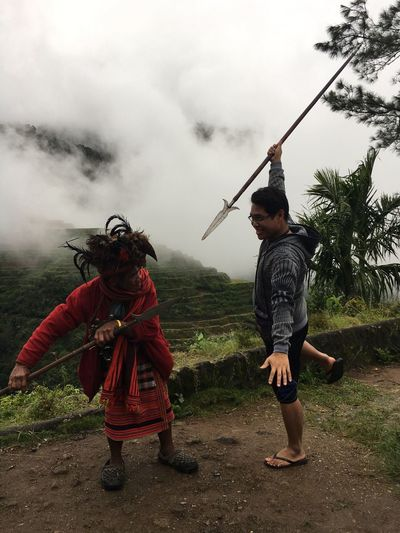 Two People Day Real People Rear View Sword Weapon Mountain Men Nature Sky BanaueRiceTerraces Banaue Ifugao Adult People Tribes Connected By Travel Connected By Travel Duel Fight Spear Tribal Costume Tribal This Is My Skin