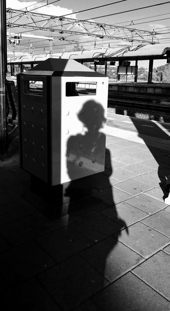 Film Noir Black And White Monochrome Self Portrait Reflection my Shadow on the Dustbin on the Train Station Way Back Home Long Shadows (c) 2016 Shangita Bose All Rights Reserved Woerden Netherlands My Commute Girl Power Feel The Journey Women Around The World