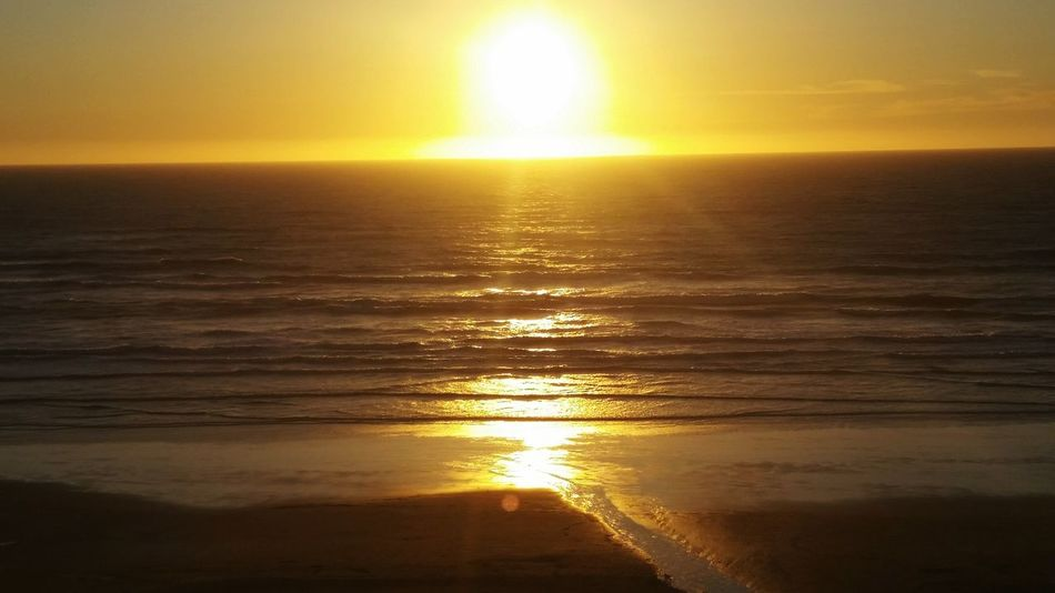 Sunset Sun Sea Reflection Sunlight Nature Tranquility Beauty In Nature Orange Color Water Gold Colored Yellow Horizon Shiny Sky Dramatic Sky Scenics No People Outdoors Beach