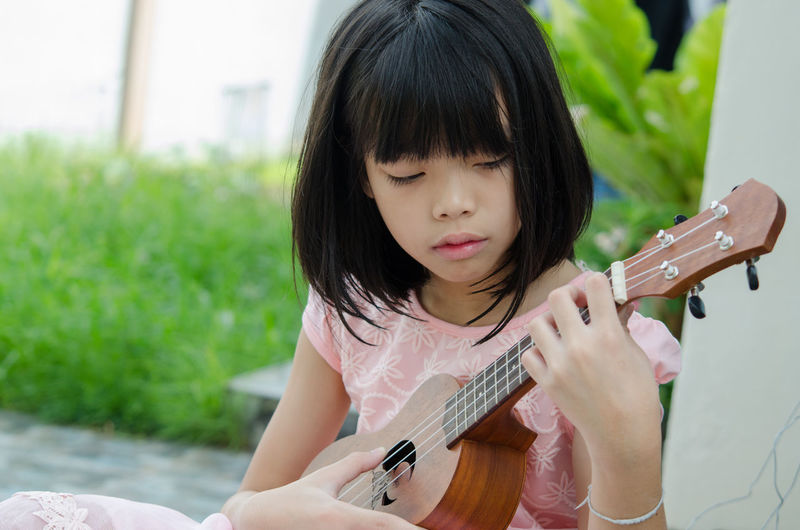 Portrait of a girl playing guitar
