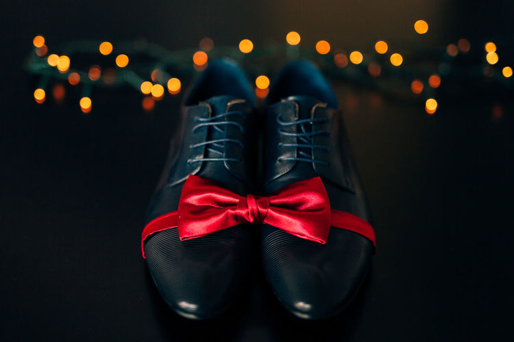 Close-up of red shoes in box against black background