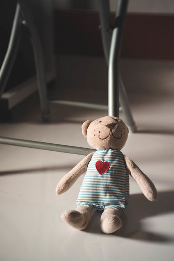 Close-up of stuffed toy hanging on table