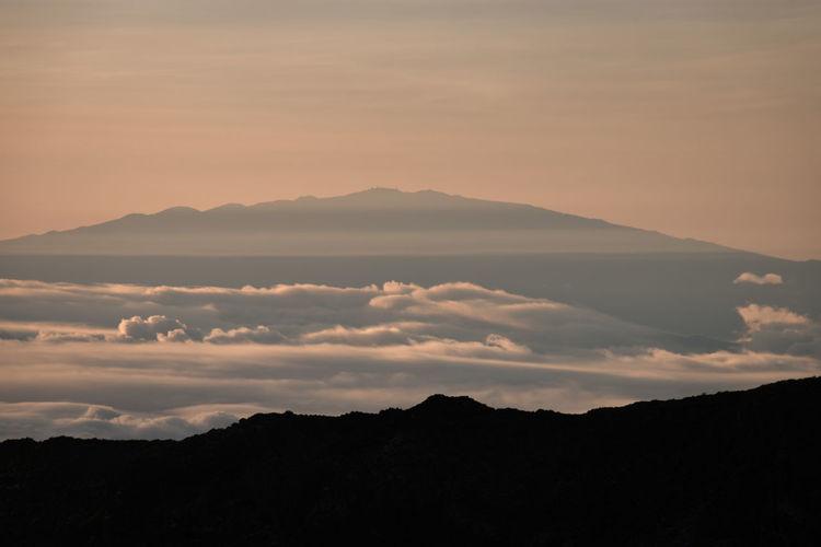 Scenic view of mauna kea, big island seen from haleakala, maui, hawaii, usa at sunrise against sky