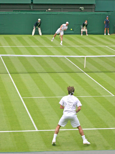 A Singles Tennis Match in the UK Federer Richard Gasquet Activity Adult Athlete Clothing Competition Competitive Sport Exercising Full Length Grass Leisure Activity Men Motion People Playing Roger Federer Sport Sports Clothing Sports Uniform Team Sport Teamwork