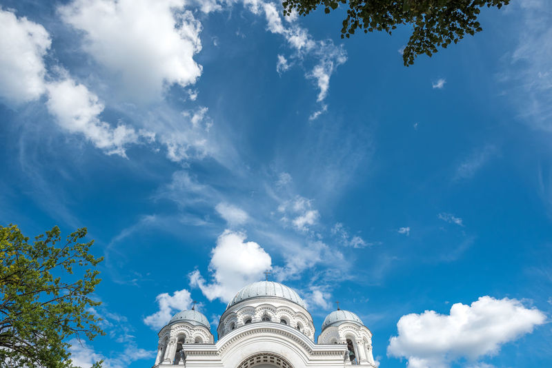 Soboras Chruch, Kaunas, Lithuania Architecture Church Green Sky And Clouds Tree Architecture Blue Building Exterior Built Structure Cloud - Sky Day History Low Angle View No People Outdoors Place Of Worship Religion Sky Soboras Spirituality Travel Destinations