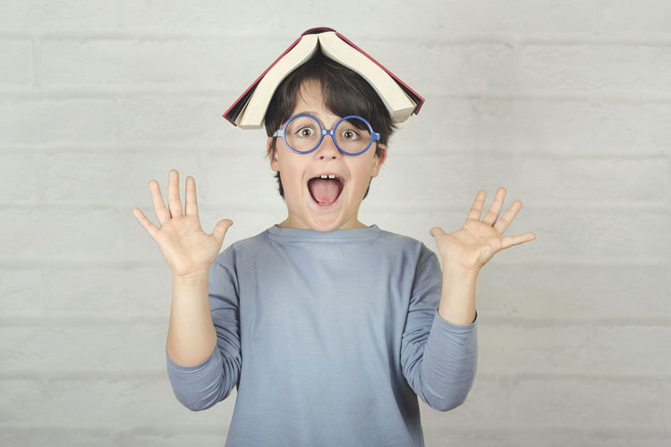 Child Book Education Wisdom Back To School Know Learn Study Student School Schoolboy Smile Lifestyle Fun Glasses Concept Read Reading Lesson Homework Ready Genius Educational Intelligence Intelligent Portrait Happy Happiness Expression Emotion Inspiration Idea Textbook Novel Children Cute People Playing Class Laughing Childhood Gesturing Standing Innocence