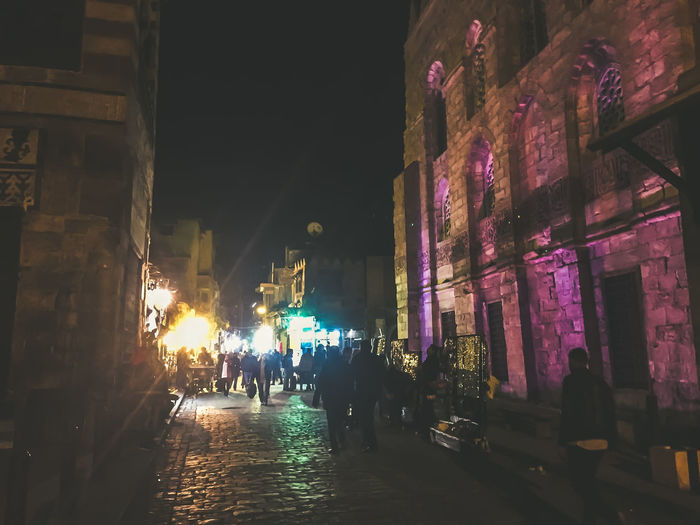 Al Muizz Street Architecture Building Exterior Built Structure Christmas Lights City Illuminated Islamic Architecture Islamic Art Islamic Cairo Islamic Calligraphy Islamic Walk Large Group Of People Mosque Night Nightphotography Outdoors People Sky Street Streetphotography