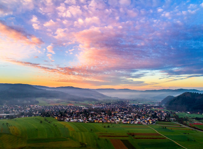 Drone  Light Morning Architecture Beauty In Nature Building Exterior Built Structure City Cityscape Cloud - Sky Community Day Dronephotography House Landscape Mountain Nature No People Outdoors Residential Building Scenics Sky Sunrise Sunset Town