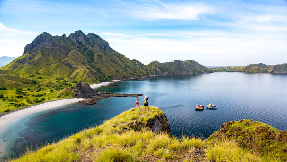 Happy Hikers Standing on Cliff Mountain, Enjoy the View Of Padar Island Before National Park, Indonesia Field Green Color INDONESIA Mountain View Top Tourist Trekking Walking Around Boat Hiker Hikers Island Mountain Nature Outdoors Padar Padar Island Pulau Route Tranquility Traveler Water
