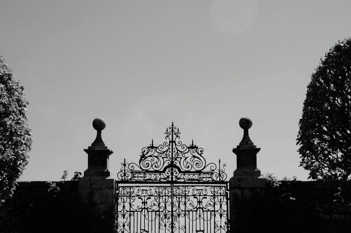 Ornate Iron Gate at Dunrobin Castle Architecture Tree Silhouette Outdoors Sky No People Built Structure Wall Gates Garden Historic Building Formal Garden Clear Sky Symmetry