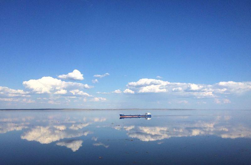 Distant ship sailing on volga river