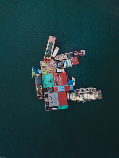 High angle view of commercial dock by sea