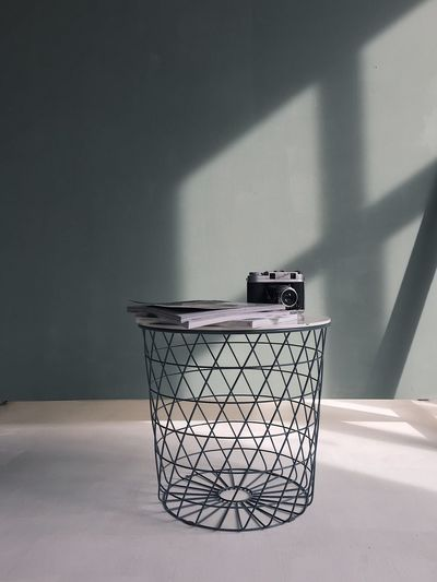 Shadow Garbage Bin Indoors  No People Sunlight Wall - Building Feature Garbage Can Environmental Conservation Container Recycling Environmental Issues Crumpled Nature Day Environment Wastepaper Basket Garbage Domestic Room Home Interior Stack