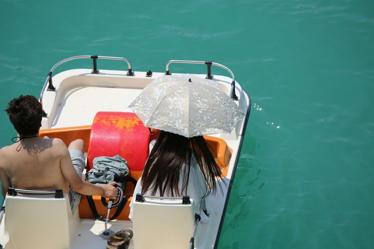 High Angle View Of Man And Woman On Pedal Boat In River