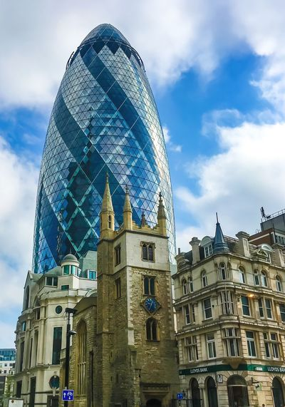 Low angle view of st andrew undershaft by 30 st mary axe against sky